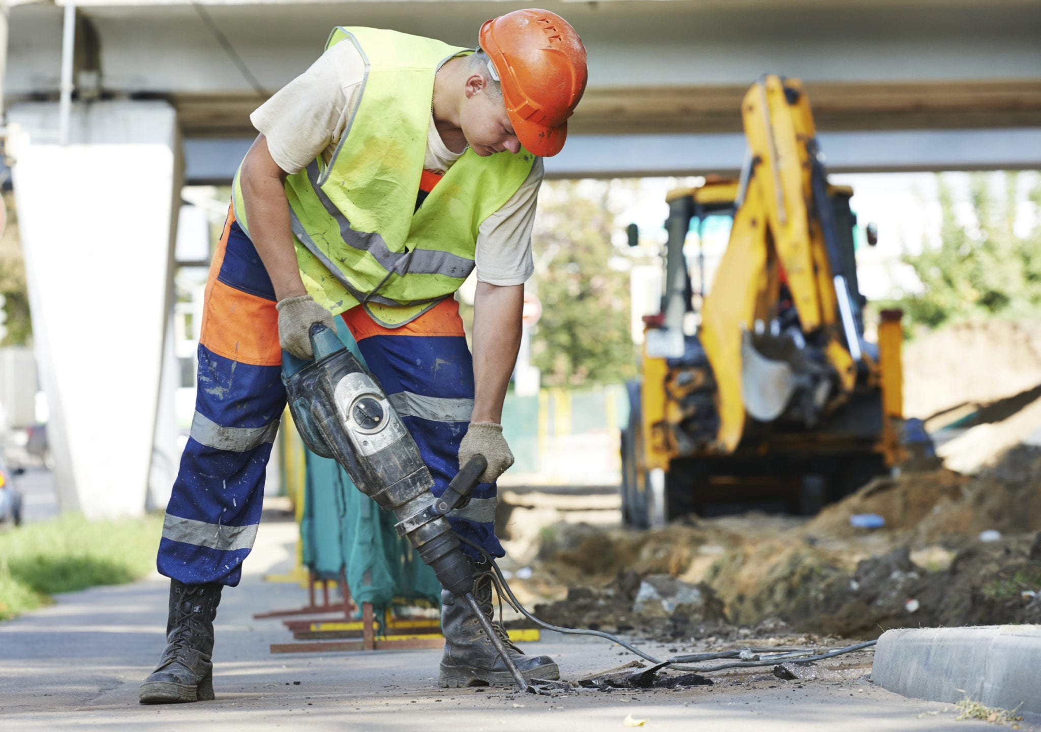 Construction Worker Working With A Large Drill Stock Photo