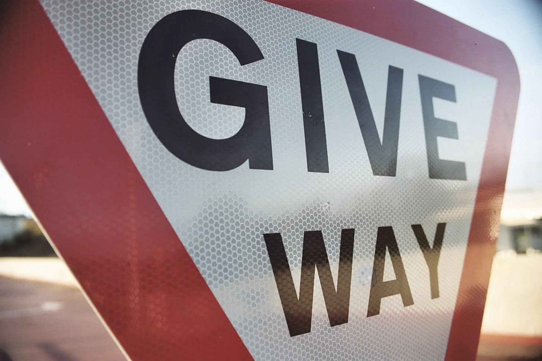Give Way Road Sign Stock Photo