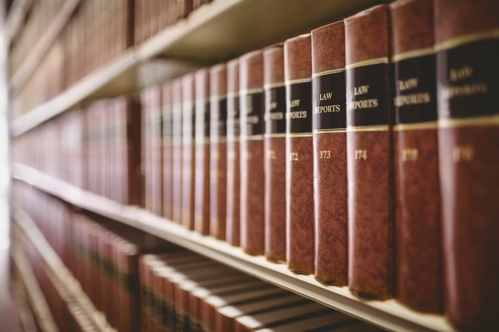 Bookshelf Of Legal Textbooks Stock Photo