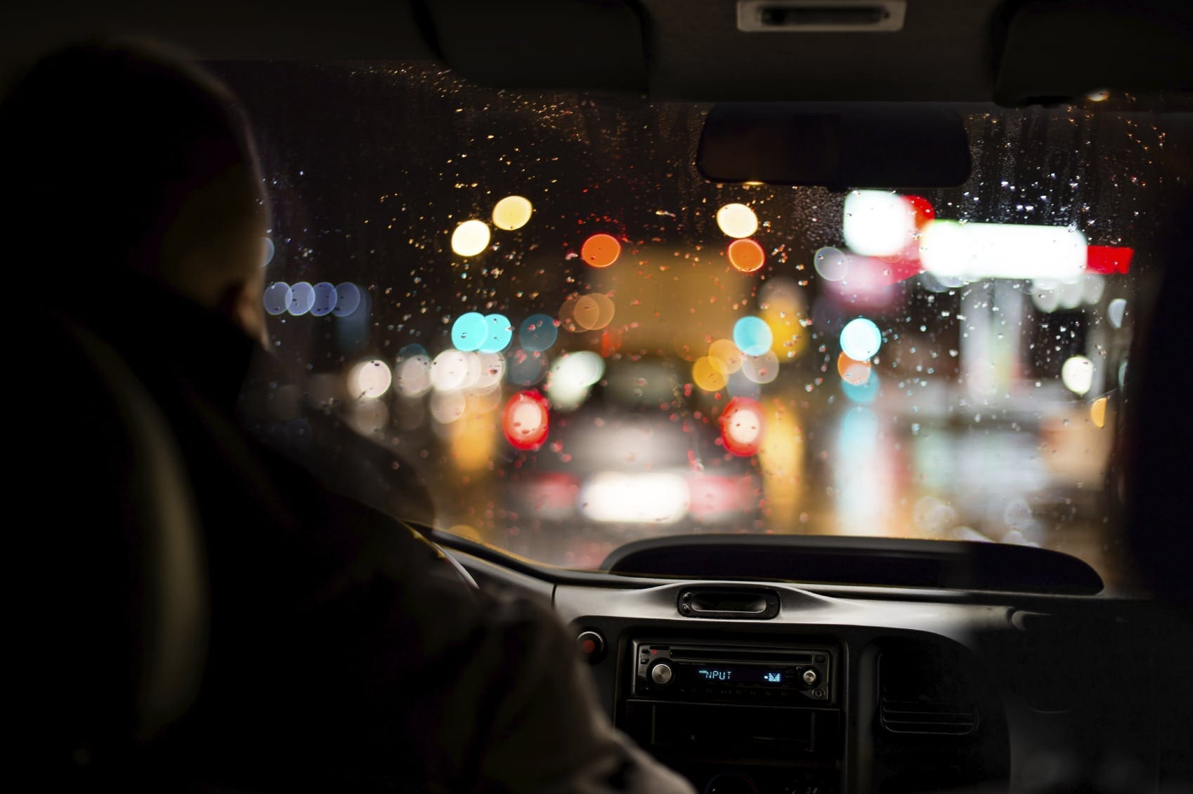 Older Man Driving His Vehicle At Night Stock Photo