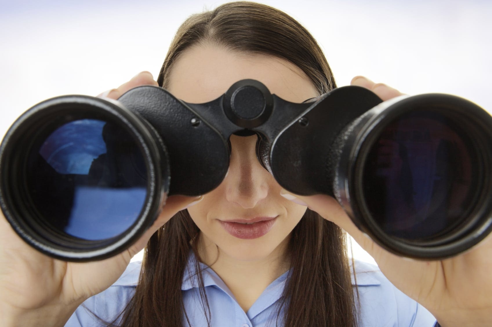 Young Woman Using Binoculars Stock Photo