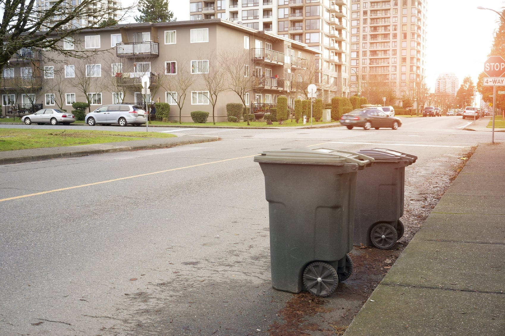 Garbage Containers On A City Street Stock Photo
