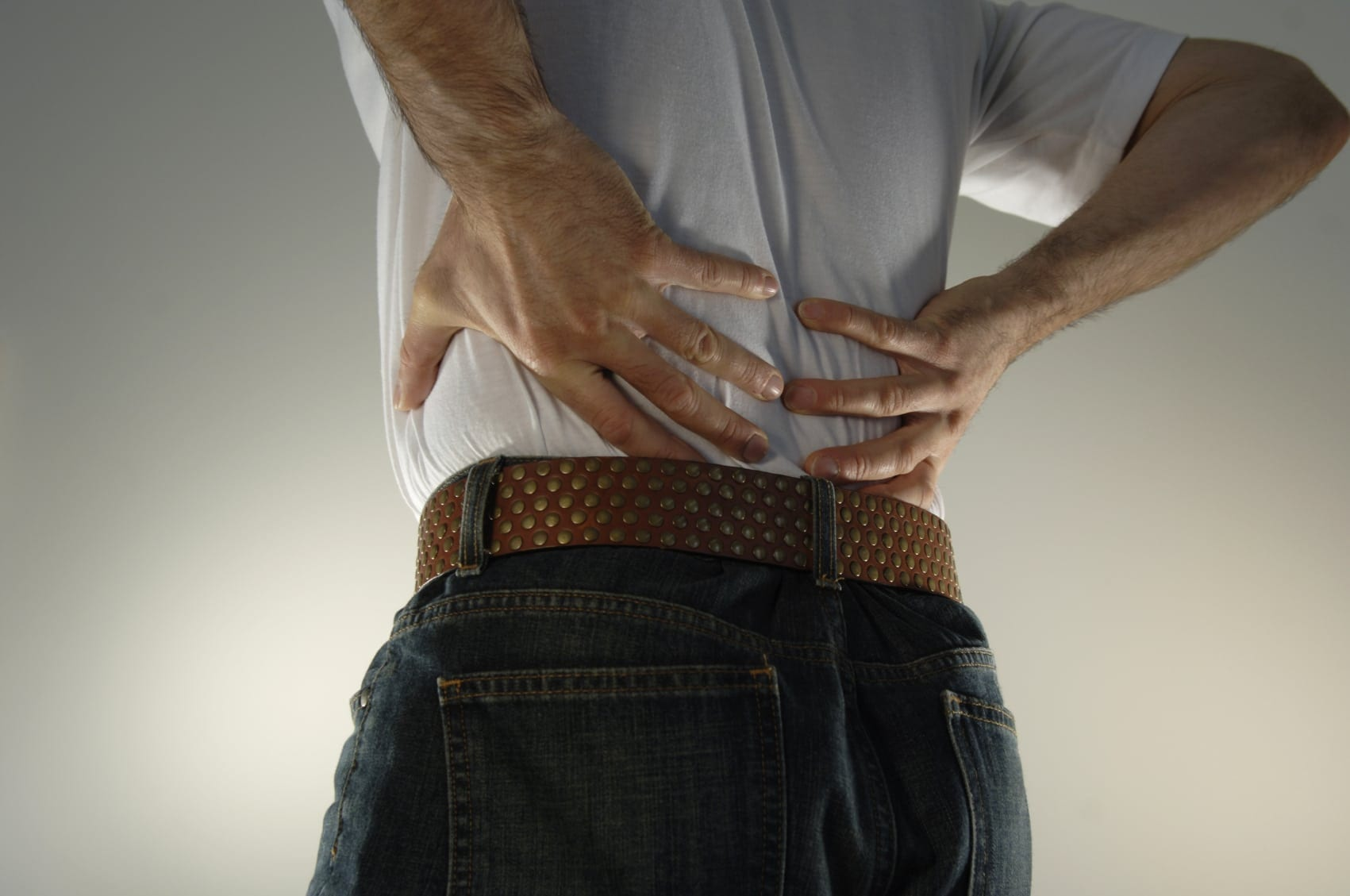 Man Experiencing Lower Back Pain Stock Photo