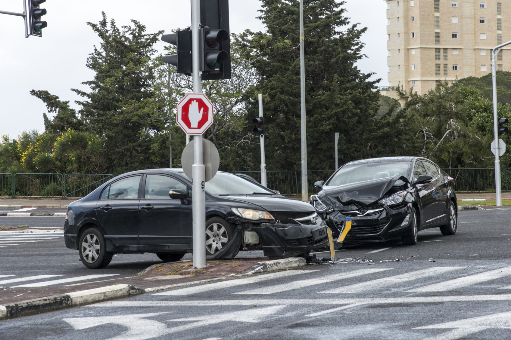 Auto Accident At City Intersection Stock Photo