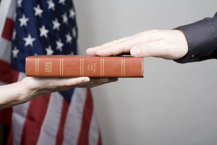 Lawyer Being Sworn In On The Holy Bible Stock Photo