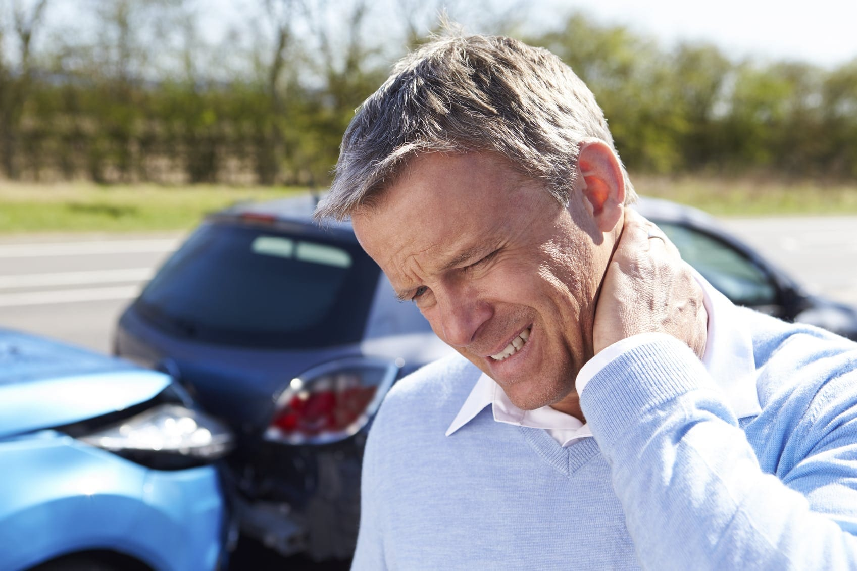 Male Driver Experiencing Neck Pain After A Rear End Car Accident