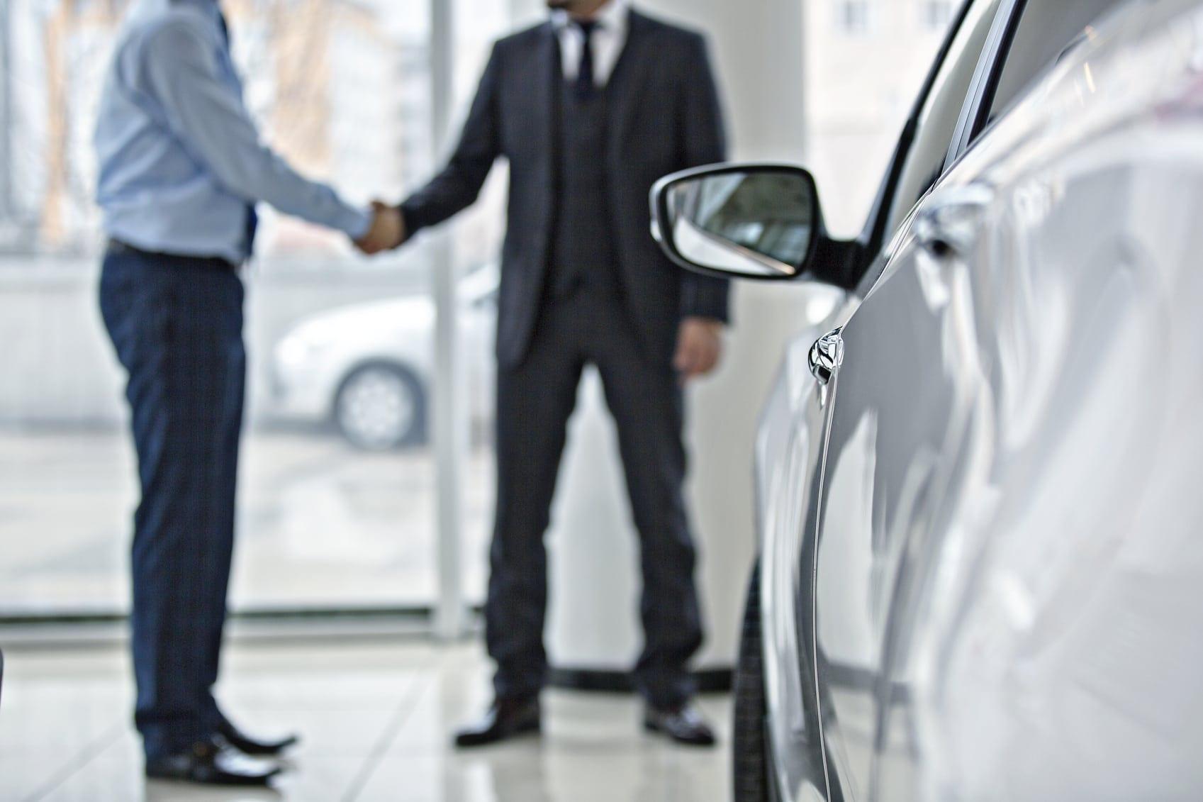 Buying new car at car showroom