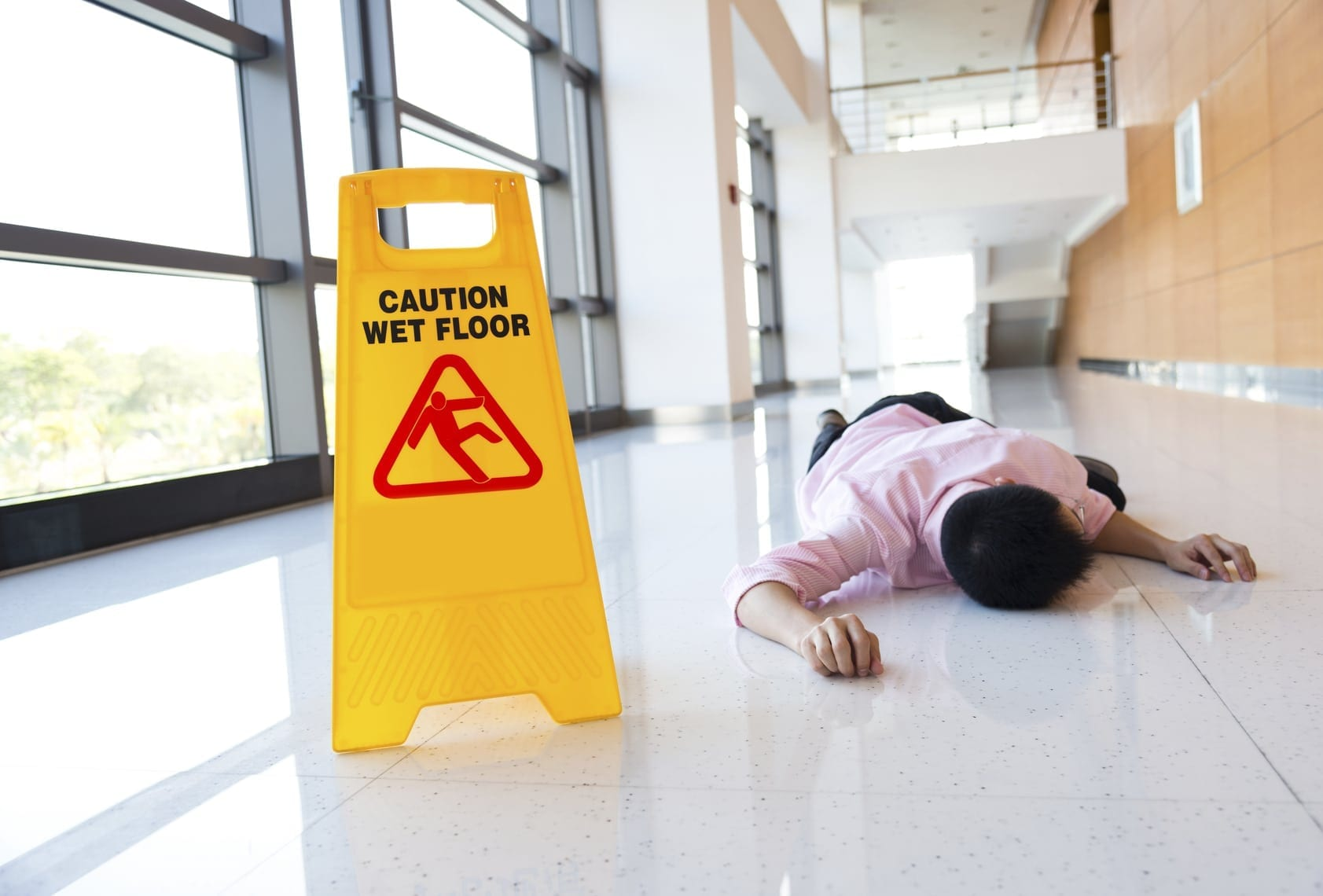 Man Laying On Ground After Slip and Fall Accident
