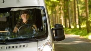 Delivery Driver Driving On A Rural Road Stock Photo