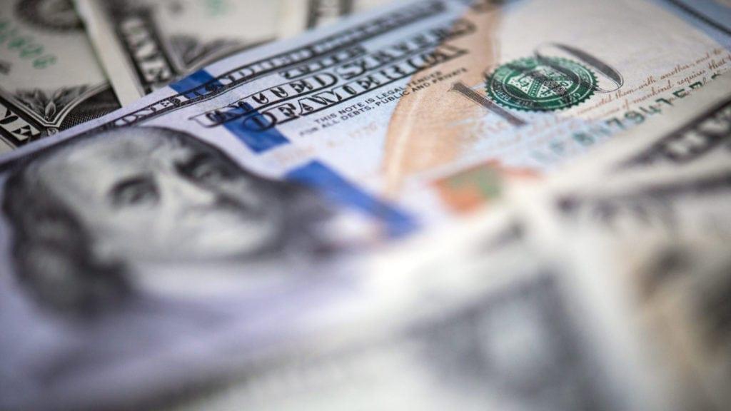 $100 US dollar bill on $1 dollar banknotes