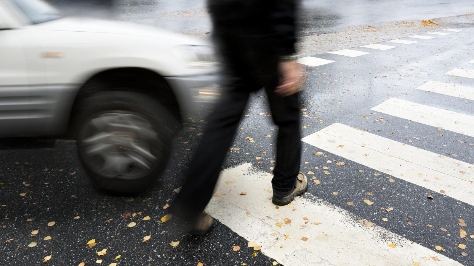 Man on pedestrian crossing in autumn