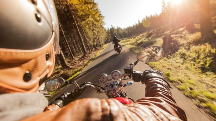 Two Motorcyclists Riding In A Rural Area Stock Photo