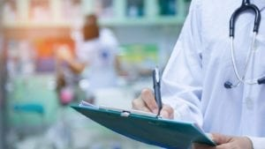 Doctor Writing A Medical Prescription Stock Photo