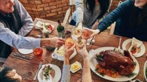 Family Toasting At Thanksgiving Dinner Stock Photo