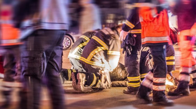 First Responders Helping An Injured Person Stock Photo