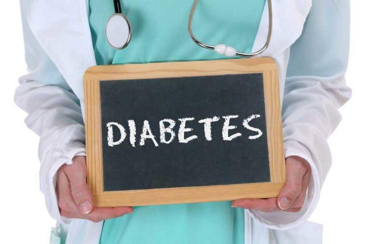 Female Doctor Holding Diabetes Sign Stock Photo
