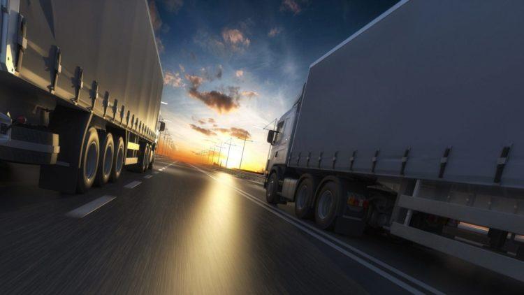 18-wheeler Trucks Driving On The Highway Stock Photo