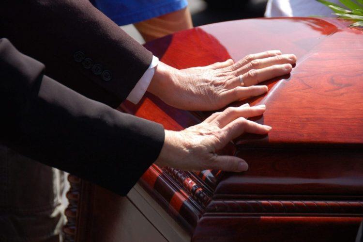 Paul Bearers Lifting A Coffin Stock Photo