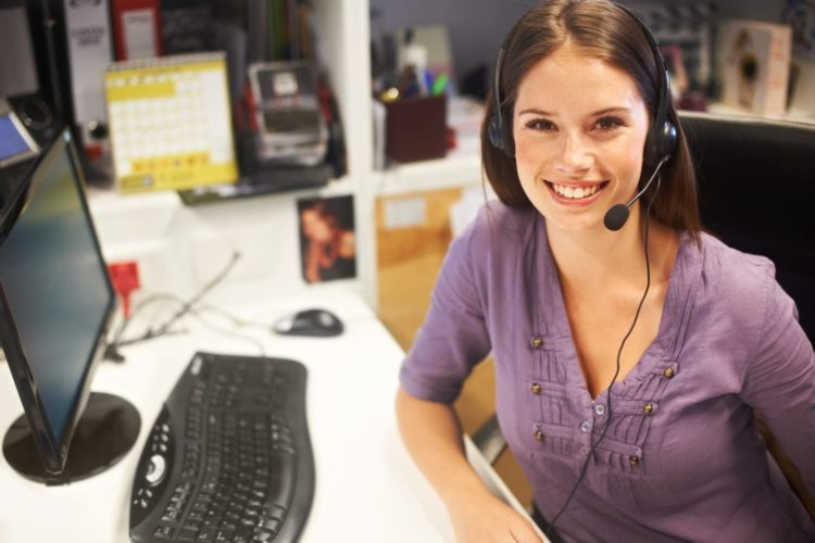Call Center Employee At Her Desk Stock Photo