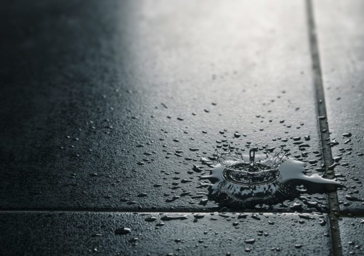 Water Dripping On A Floor Stock Photo