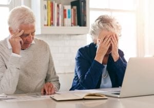 Distressed Elderly Couple Stock Photo