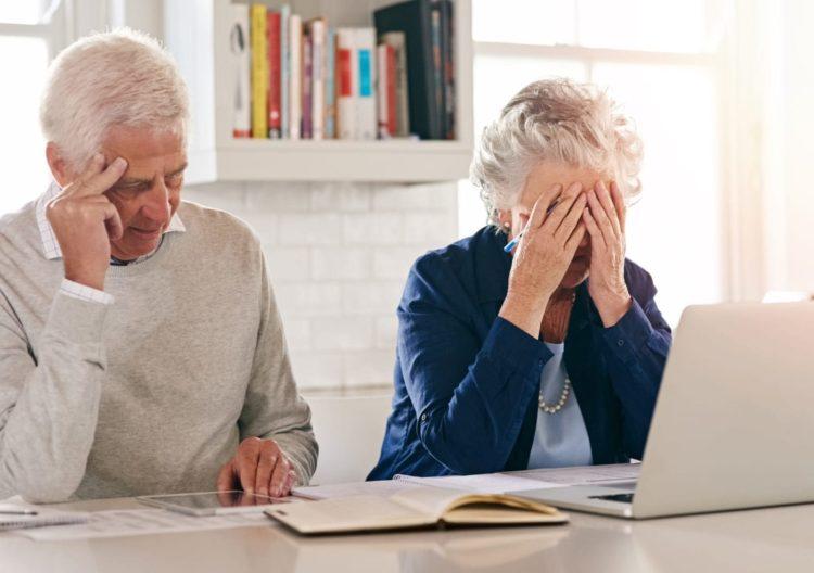 Distressed Elderly Couple Stock Photo