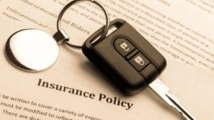 Car Keys and Insurance Policy Stock Photo