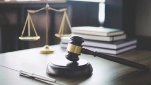 Scales of Justice With Gavel Stock Photo