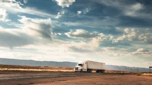 Semi-truck Driving On A Rural Highway Stock Photo