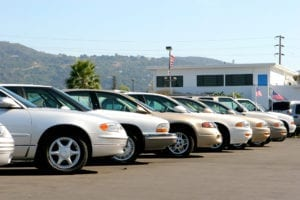 cars lined up in a car lot