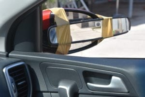 funny improvisation, a mirror paste on a side mirror of a vehicle
