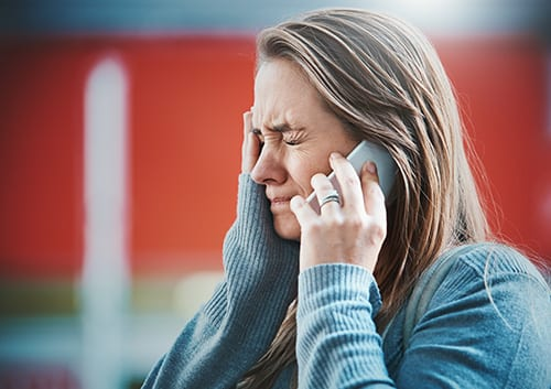 Distressed woman talking on phone