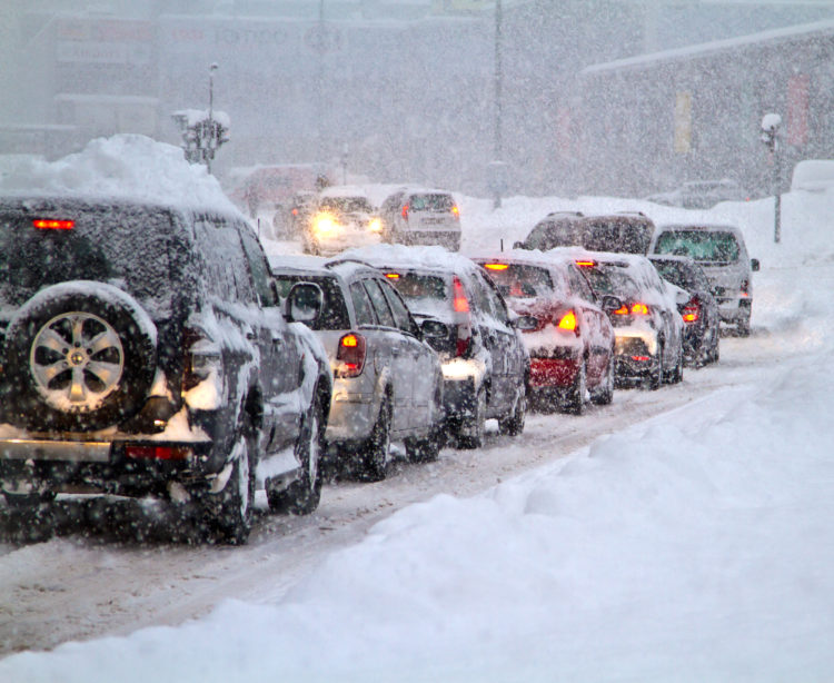cars navigating winter weather in Indiana