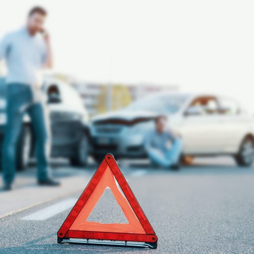 man calling an auto accident attorney after accident in Indianapolis