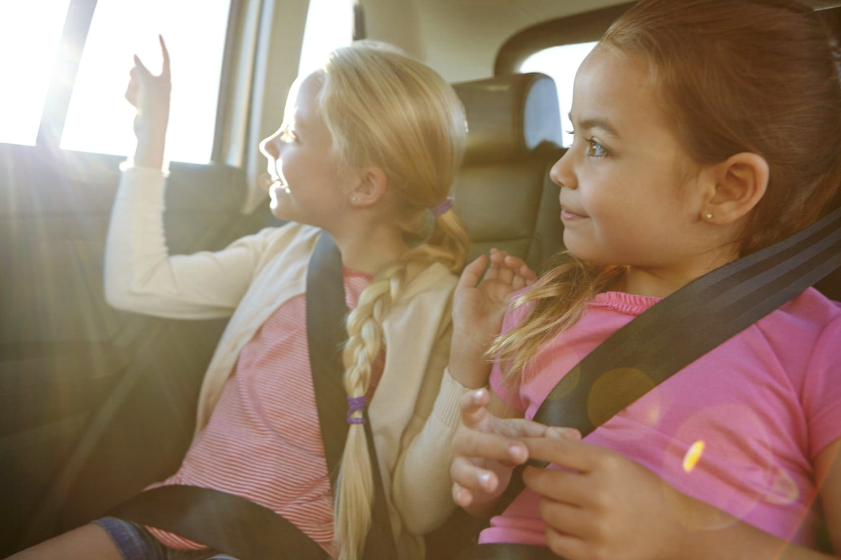 Young Children Sitting In The Backseat Of A Vehicle Stock Photo