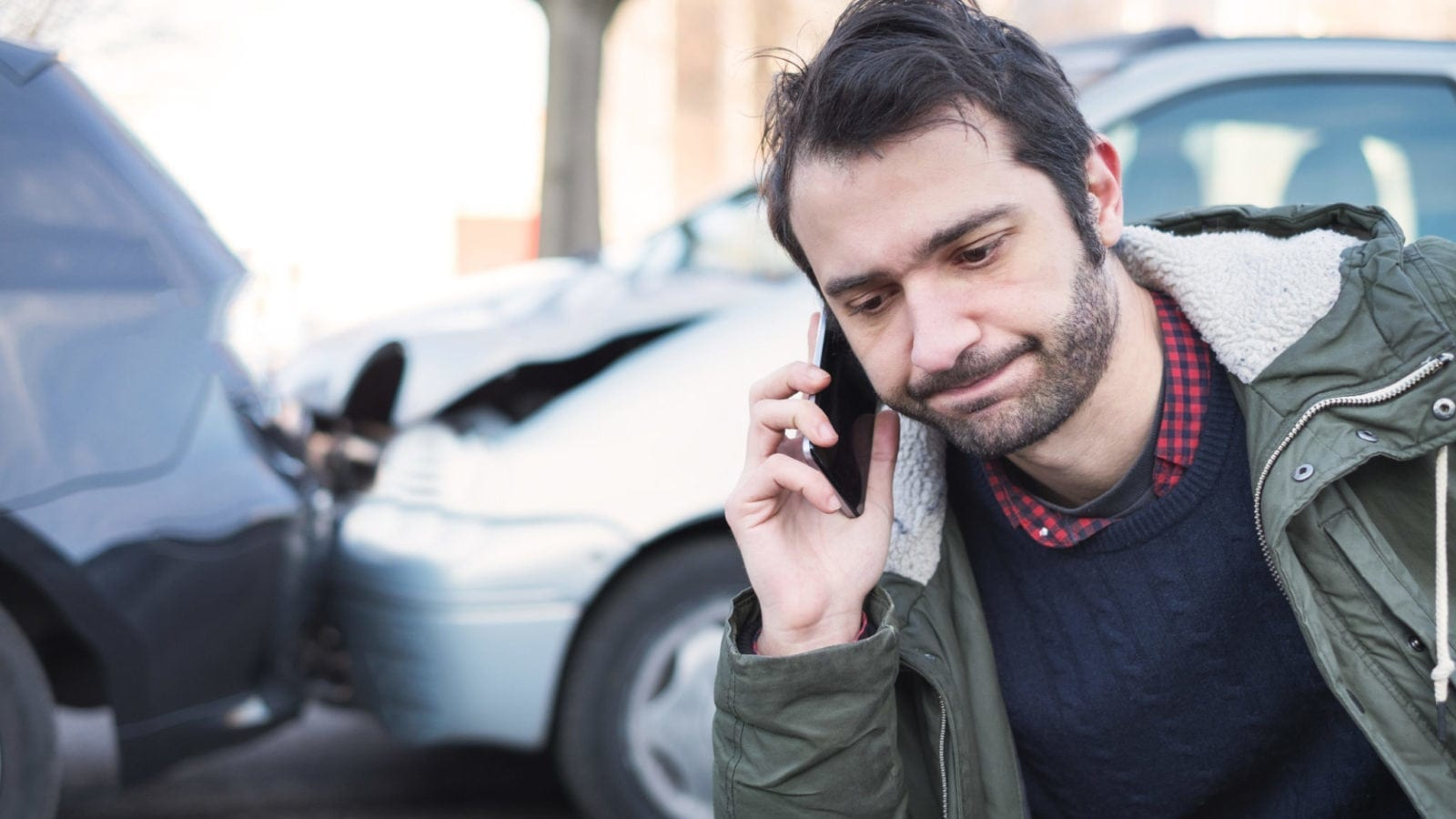 Male Driver Calling His Insurance Provider After A Car Accident Stock Photo