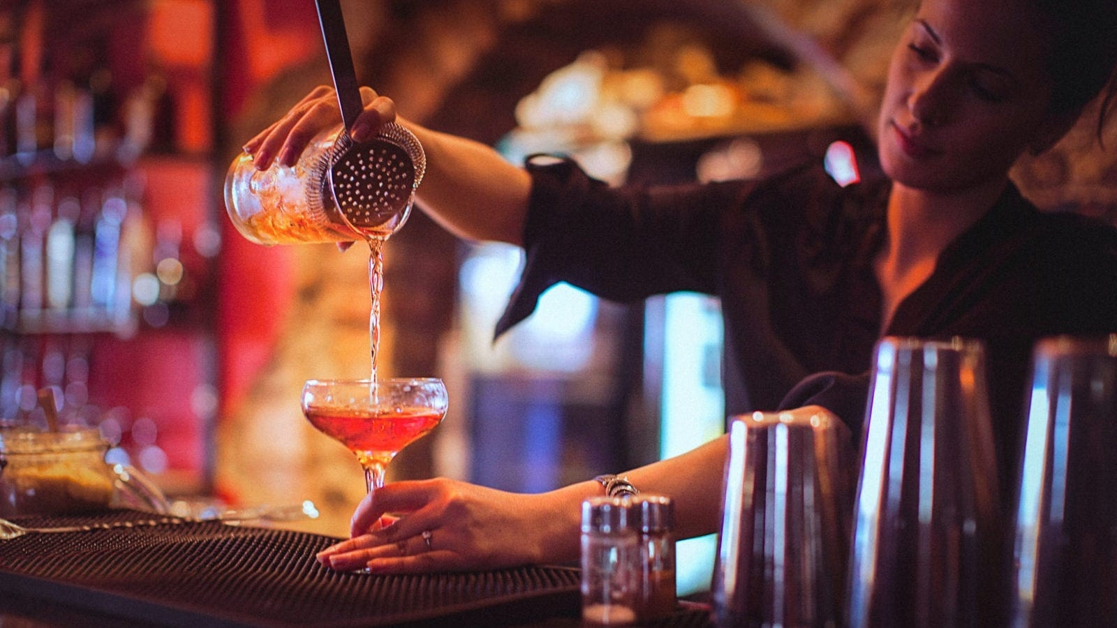 Bartender Pouring A Cocktail Stock Photo