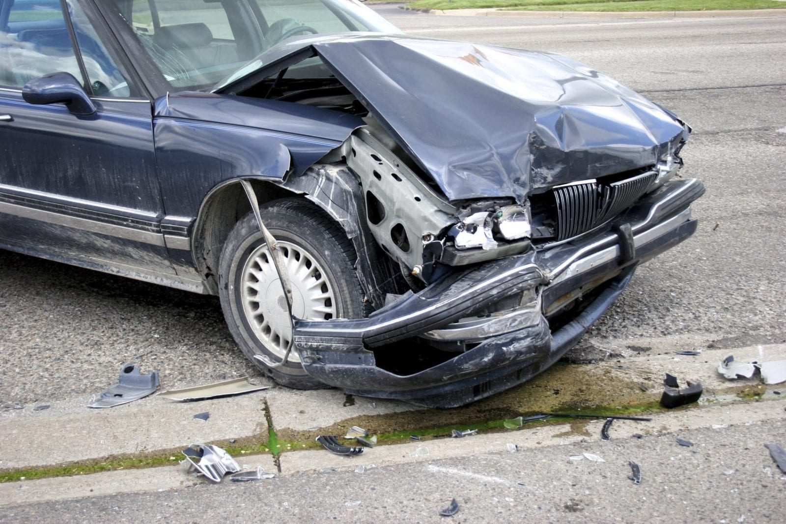 Navy Blue Sedan With Severe Front End Damage Stock Photo
