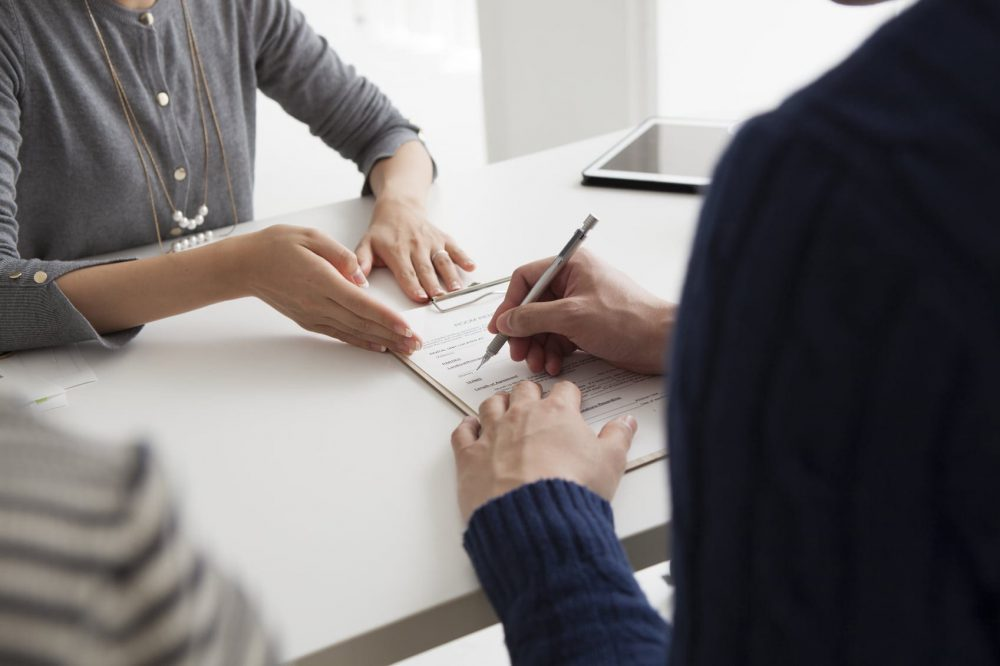 Woman Signing A Contract Or Legal Document Stock Photo