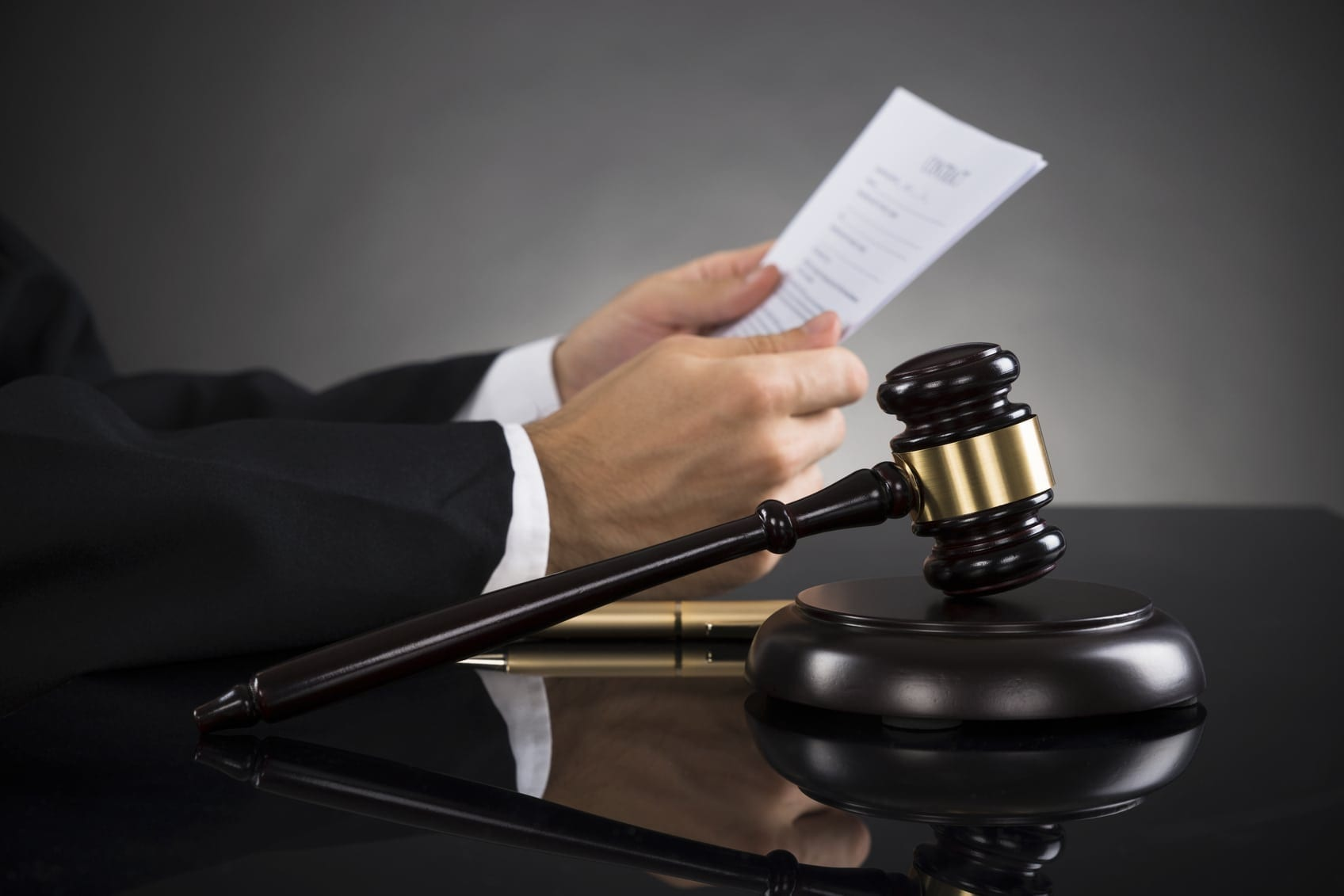 Judge Reviewing Legal Documents Stock Photo