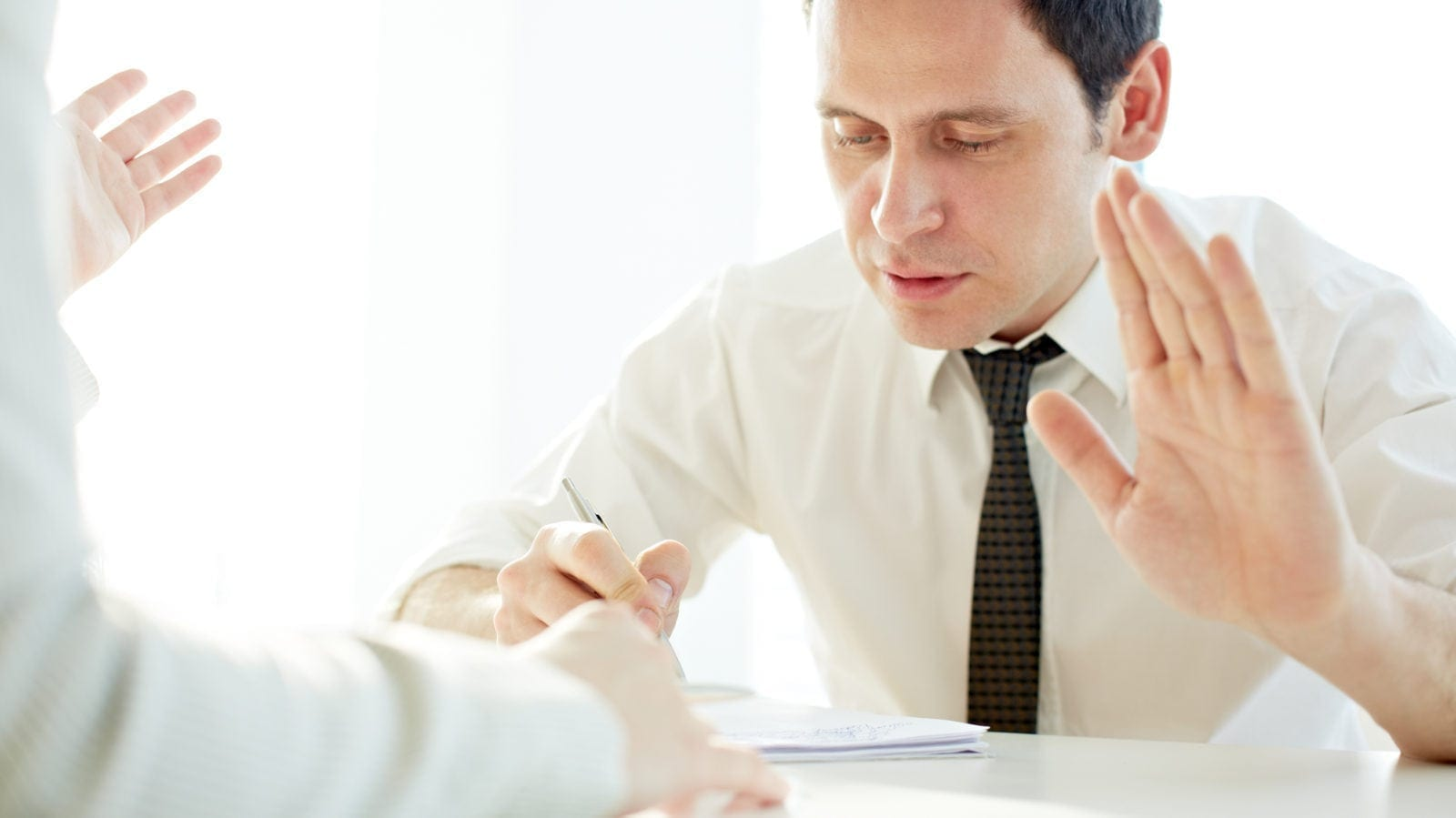 """Man Saying """"Stop"""" While Listening To Another Person Stock Photo"""