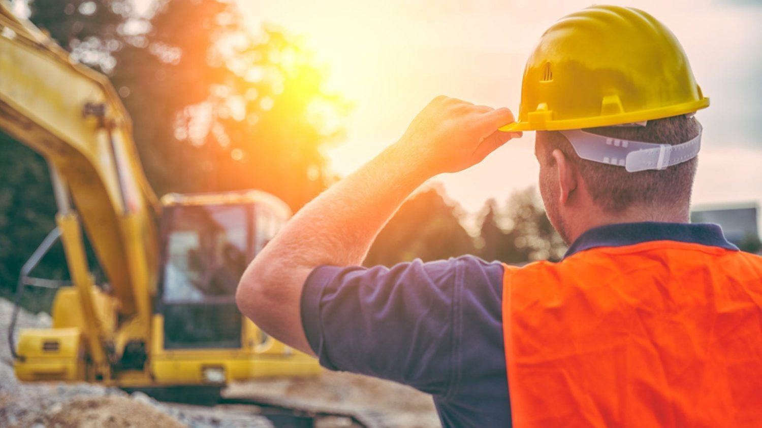 Construction Worker Wearing A Hard Hat Stock Photo
