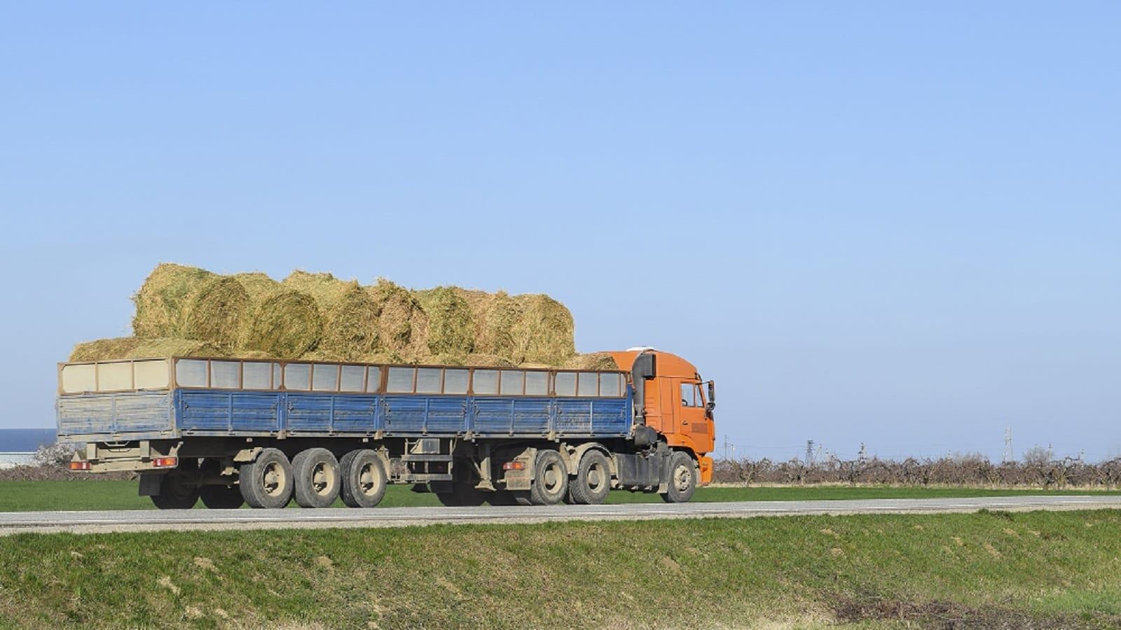 Large Truck Carrying Bails Of Hay Stock Photo