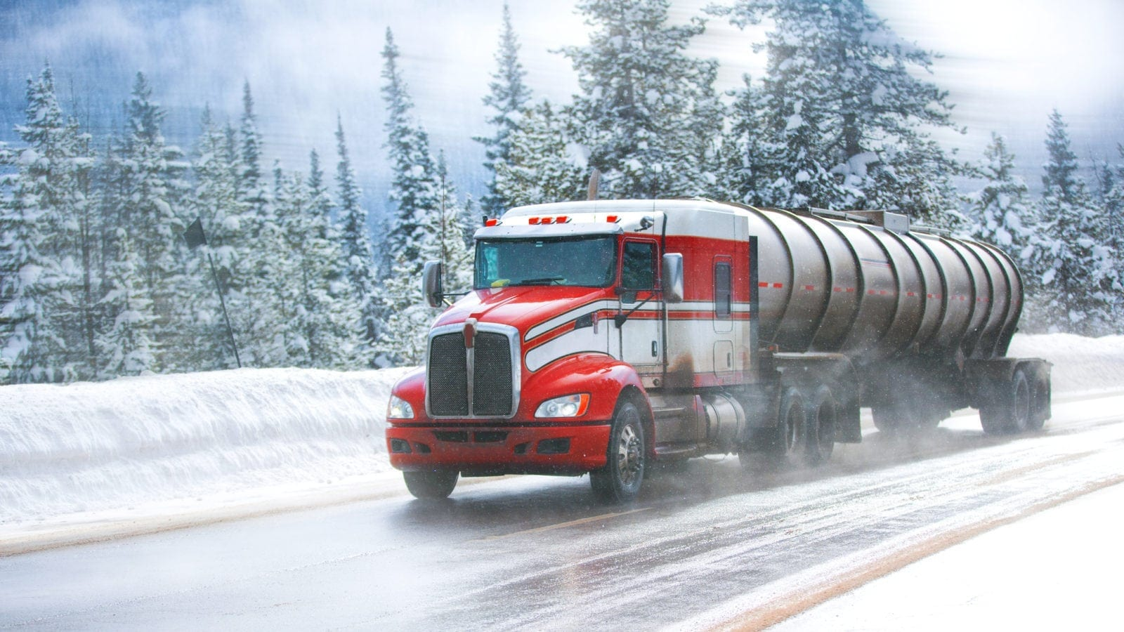 Large Semi-truck Driving On An Icy Road Stock Photo