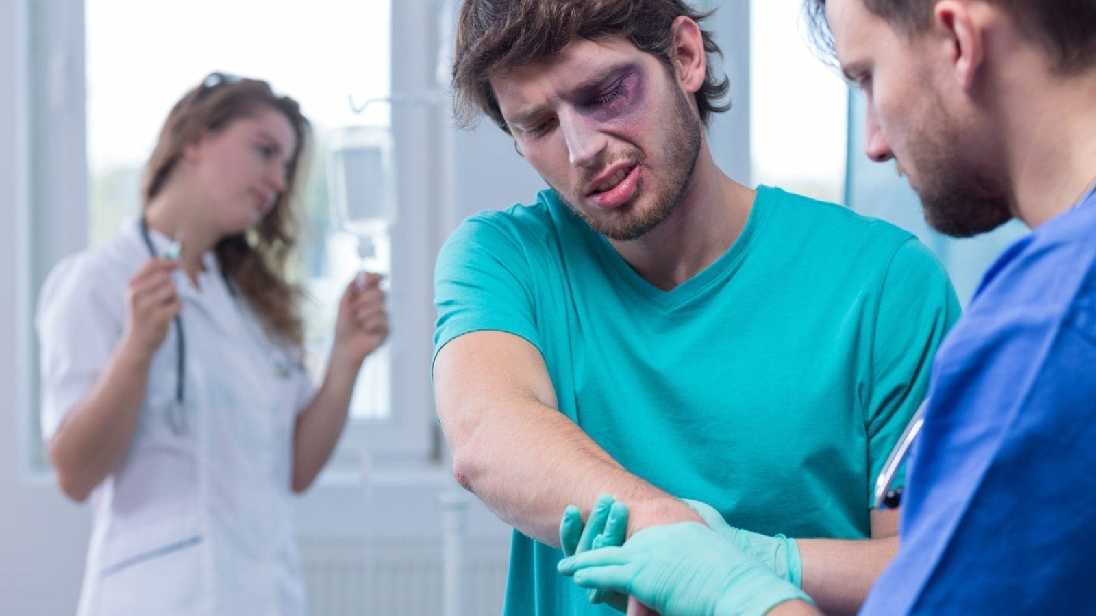 Injured Man Being Examined By A Male Nurse Stock Photo