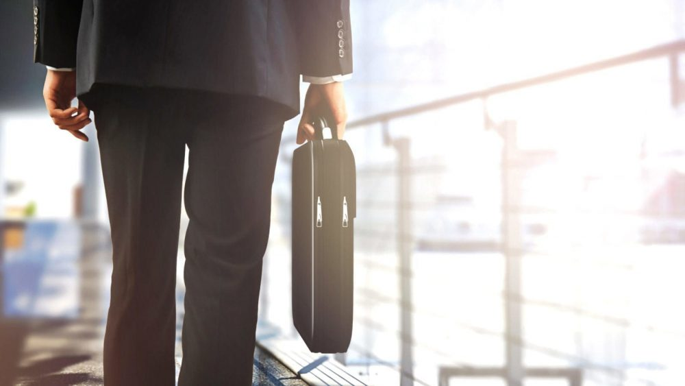 Businessman Walking With A Briefcase Stock Photo