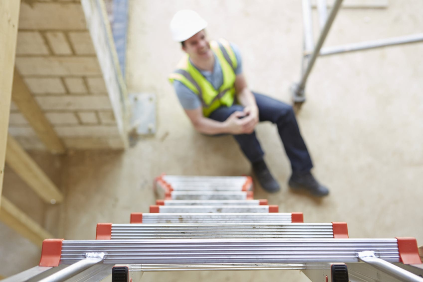 Worker Falling Off Ladder And Injuring Leg Stock Photo
