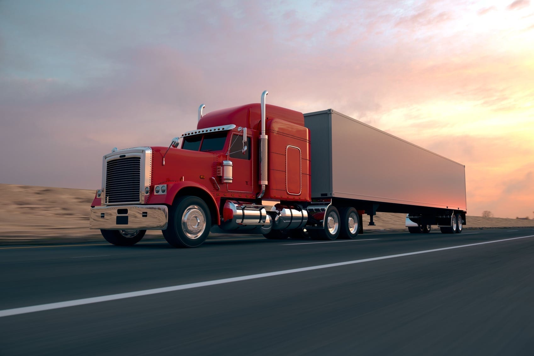 Red Semi-truck Driving On The Interstate Stock Photo
